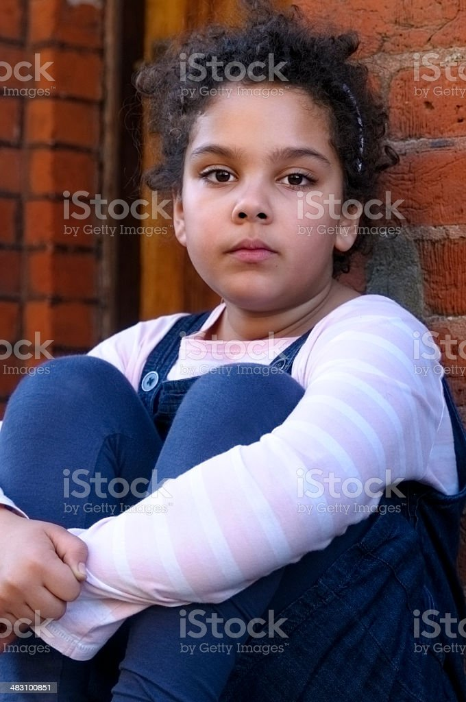 PEOPLE: Portrait Of Child (7-8) Sitting Outside royalty-free stock photo