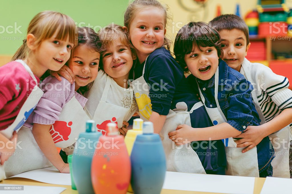 Portrait of Children Painting With Watercolors stock photo
