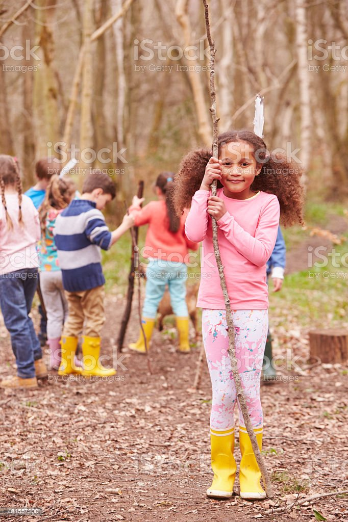 Portrait Of Children Playing Adventure Game In Forest stock photo