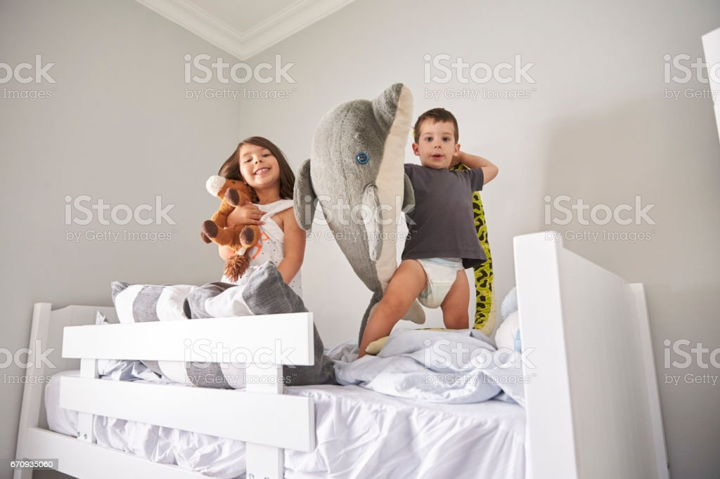 Portrait Of Children Playing With Toys In Bunk Bed stock photo