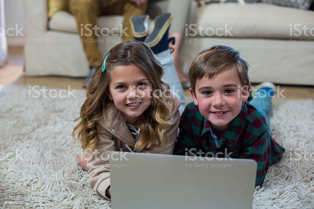 Portrait of children using laptop stock photo
