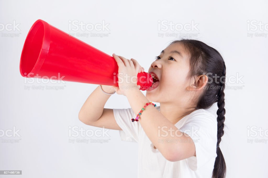 Portrait of chinese asian cute girl with megaphone stock photo
