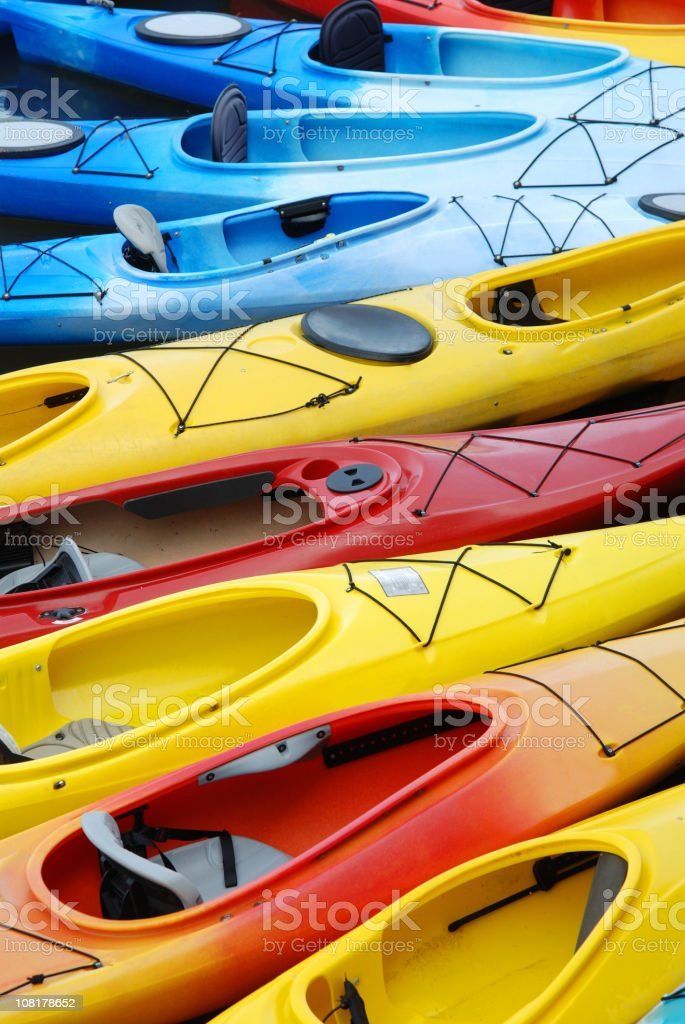 Portrait of Colorful Kayaks in Row stock photo