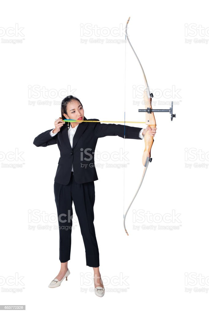 Portrait of concentrated female with crossbow in hands over white background stock photo