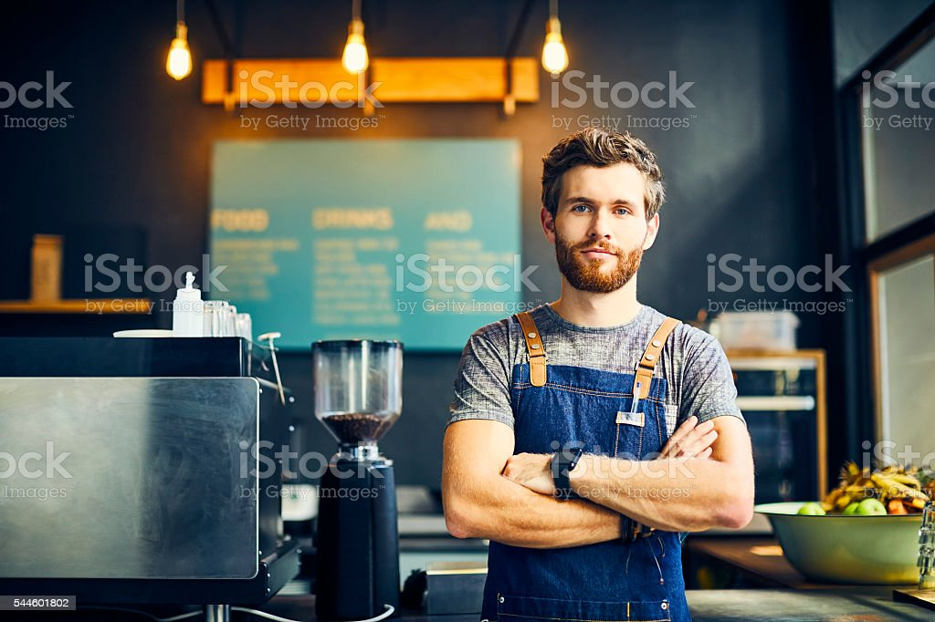 Portrait of confident barista in cafe stock photo