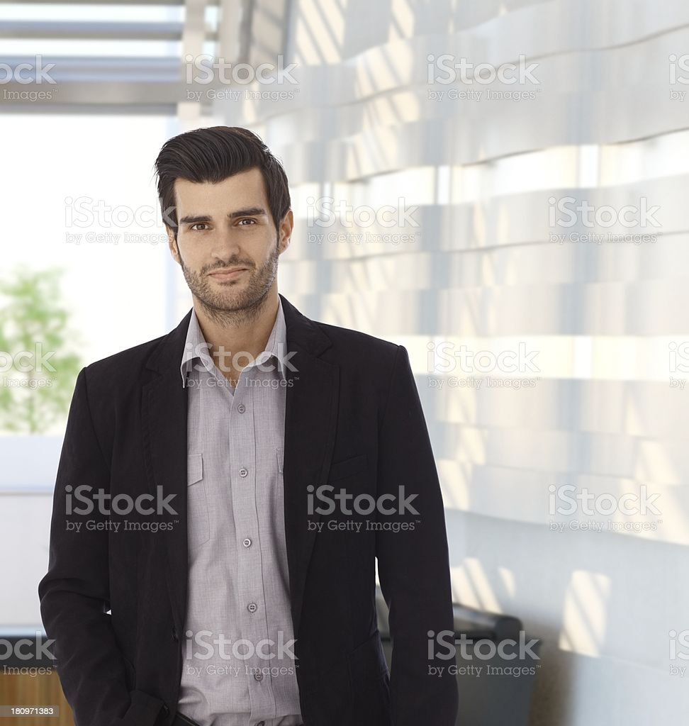 Portrait of confident businessman at office stock photo