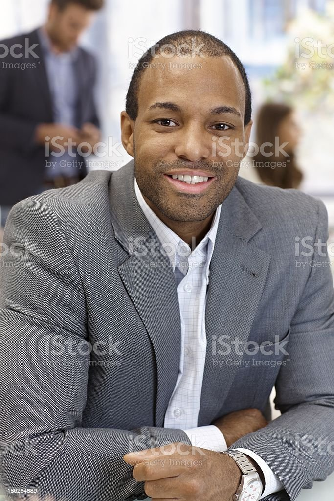 Portrait of confident businessman smiling royalty-free stock photo
