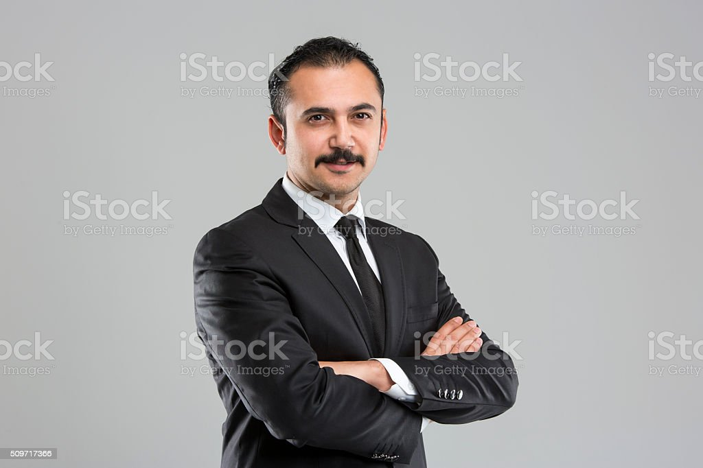 Portrait Of Confident Businessman With Arms Crossed stock photo