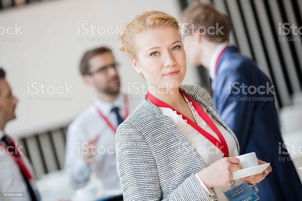 Portrait of confident businesswoman holding coffee cup stock photo