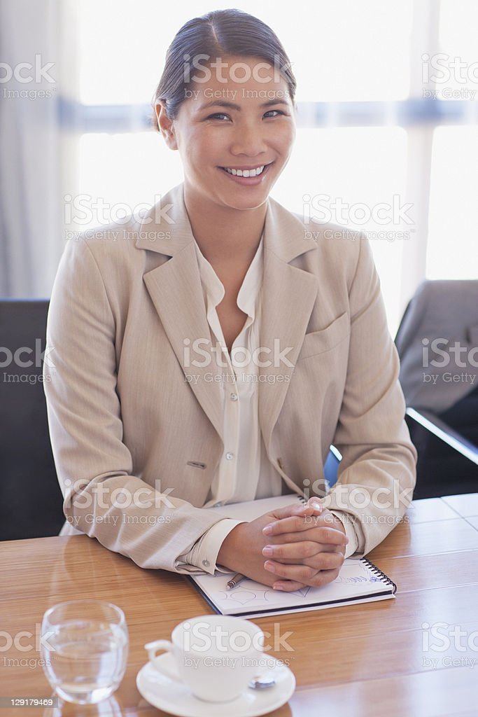 Portrait of confident businesswoman sitting in board room royalty-free stock photo