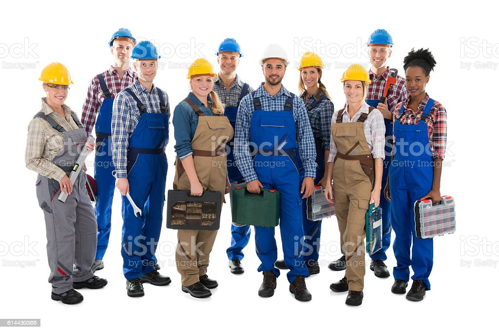Portrait Of Confident Carpenters Carrying Toolboxes stock photo