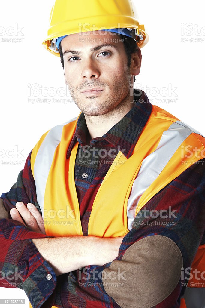 Portrait of confident construction worker with hands folded royalty-free stock photo