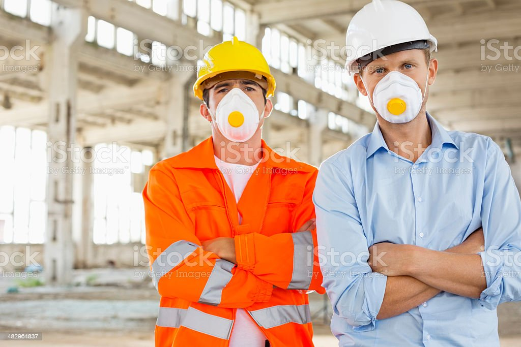 Portrait of confident male construction workers stock photo
