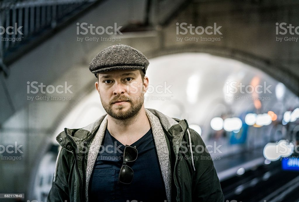 Portrait of confident man at railroad station stock photo