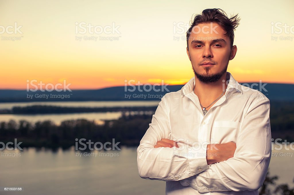 Portrait of confident man standing outdoors stock photo