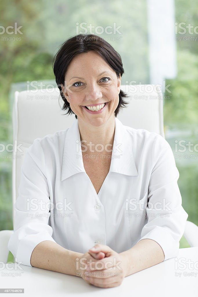 Portrait of confident mature female doctor royalty-free stock photo