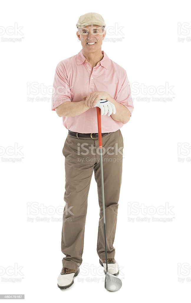 Portrait Of Confident Mature Man With Golf Club stock photo