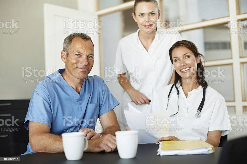 Portrait of confident medical professionals smiling royalty-free stock photo
