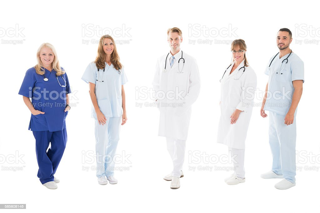 Portrait Of Confident Medical Team Standing In Row stock photo