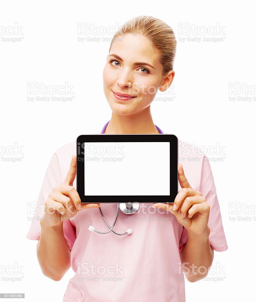Portrait Of Confident Nurse Showing Digital Tablet stock photo
