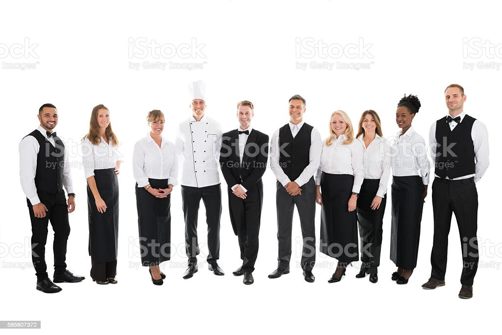 Portrait Of Confident Restaurant Staff Standing In Row stock photo