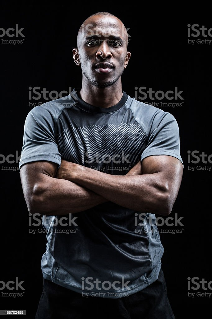 Portrait of confident rugby player with arms crossed stock photo