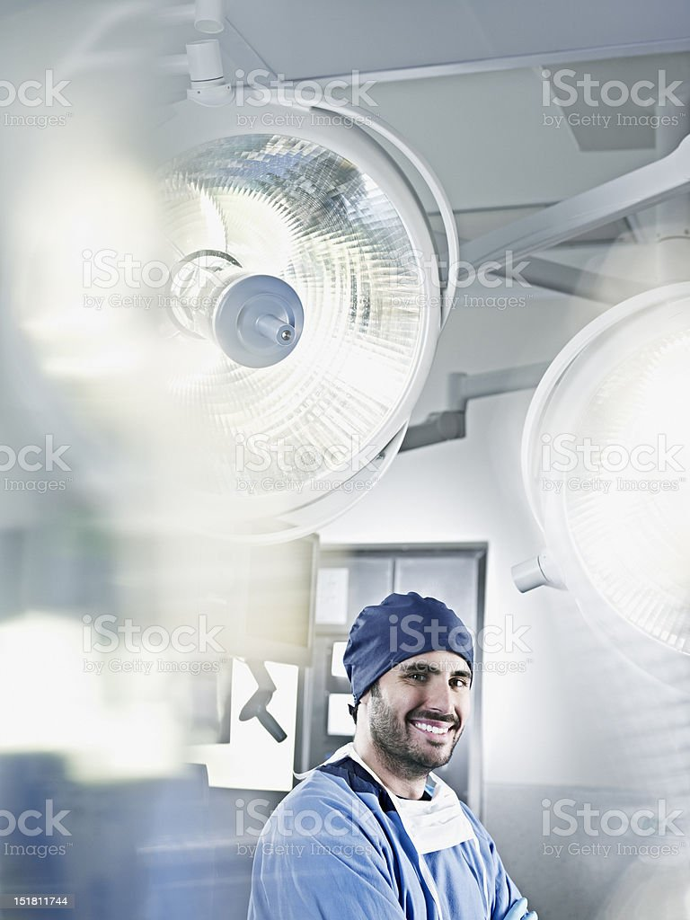 Portrait of confident surgeon under surgical lights stock photo