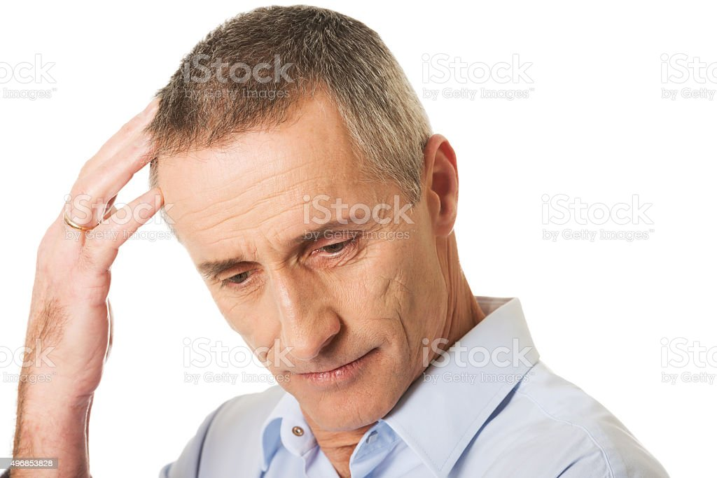 Portrait of confused man scratching his head stock photo