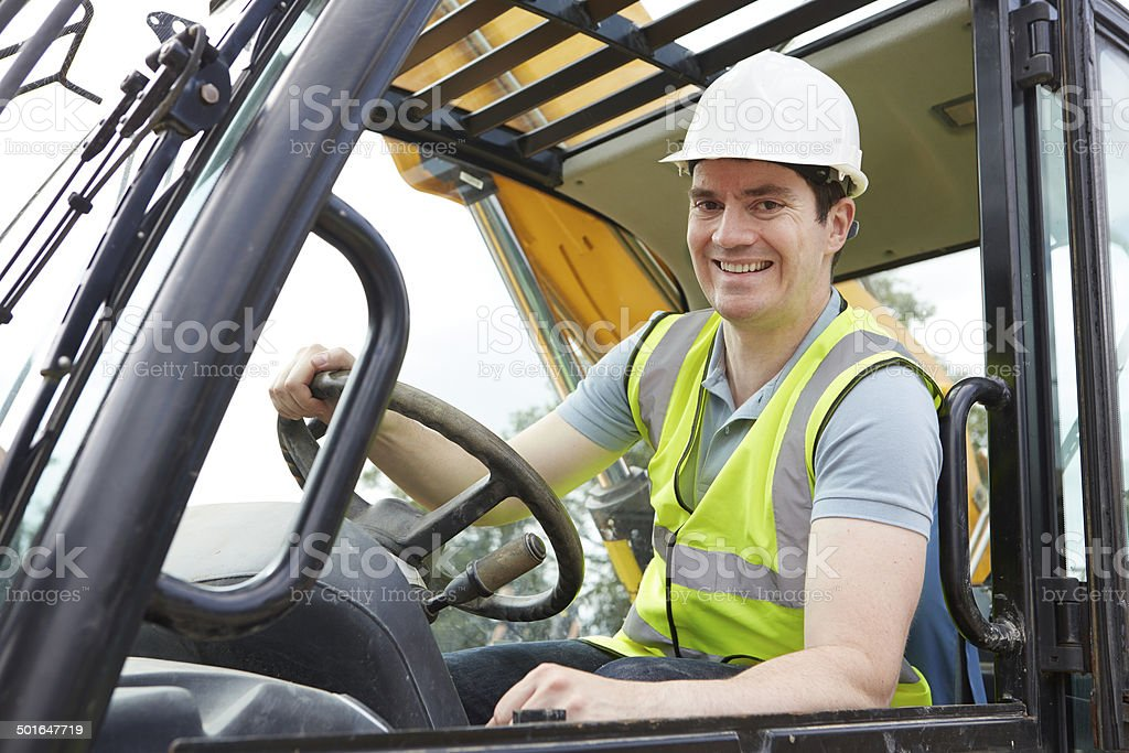 Portrait Of Construction Worker Driving Digger stock photo