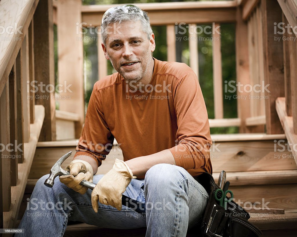 Portrait of Construction Worker Holding Hammer royalty-free stock photo