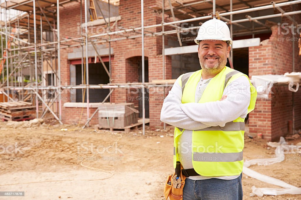 Portrait Of Construction Worker On Building Site stock photo