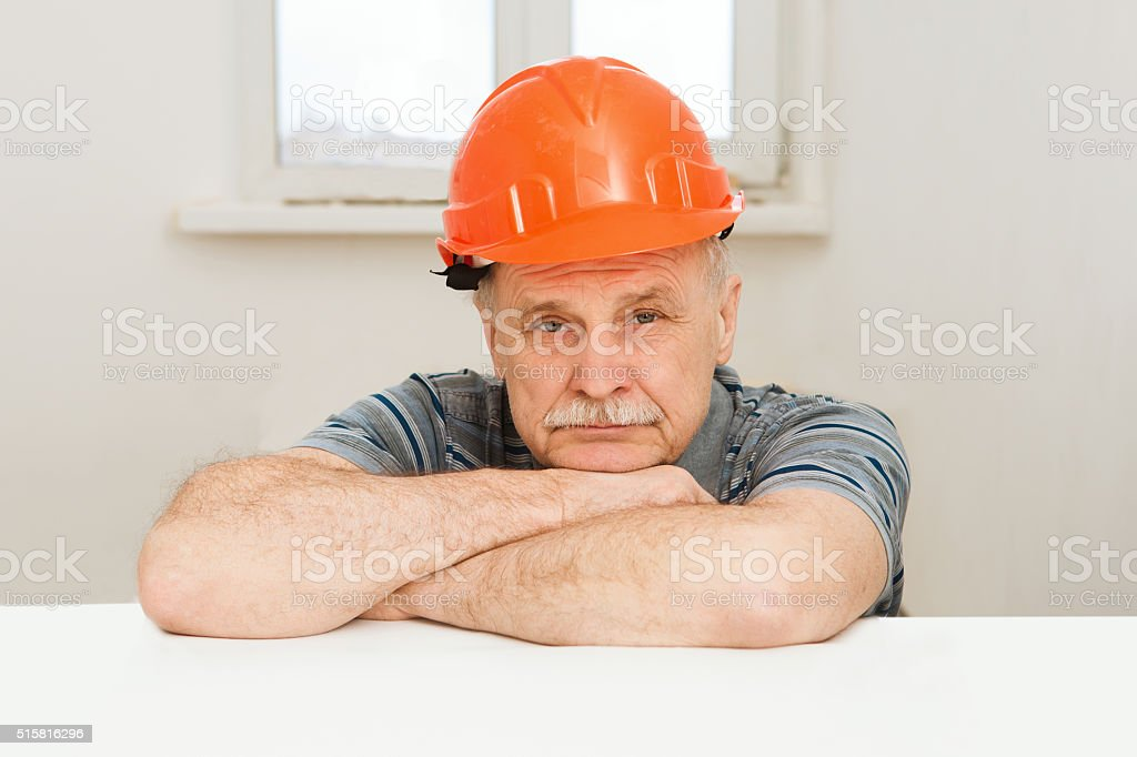 portrait of construction worker with orange hat stock photo