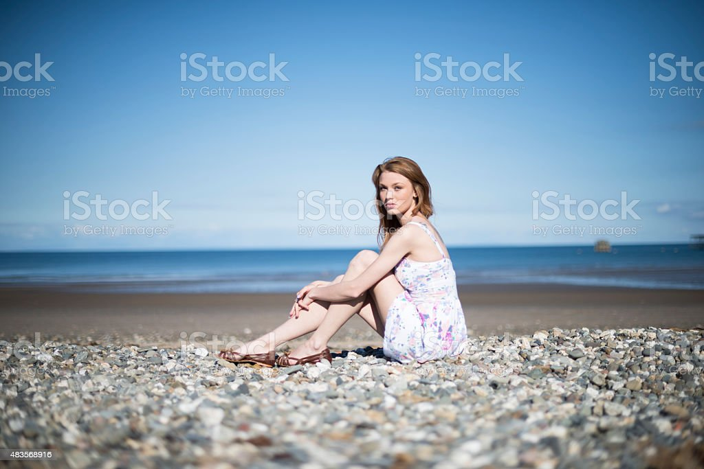 Portrait of contemplative young woman on a beach stock photo