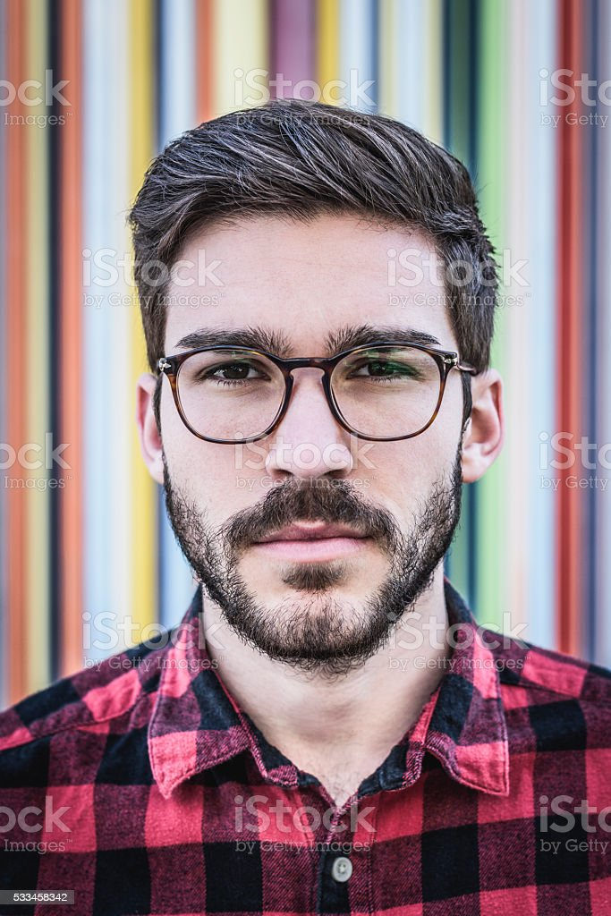 Portrait of cool French hipster dude with beard and glasses stock photo