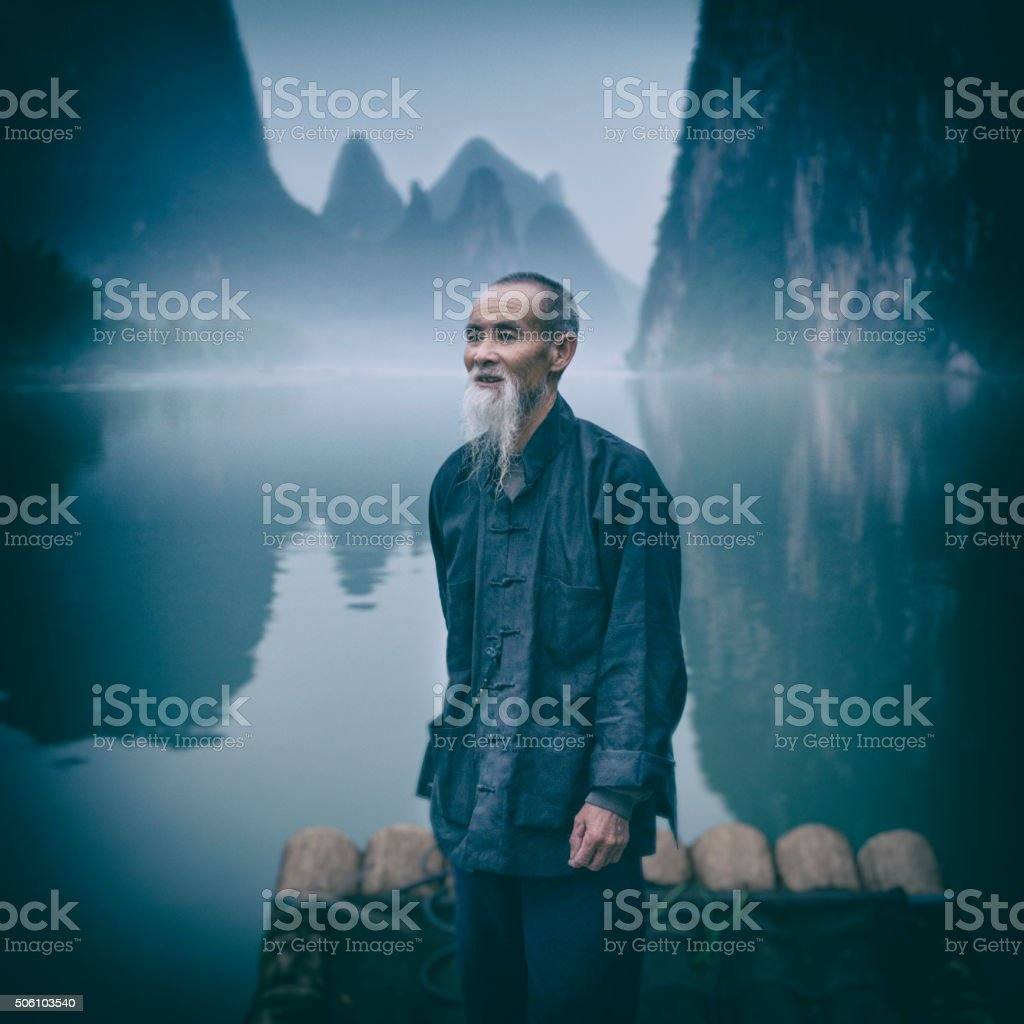 Portrait of Cormorant Fisherman on River Lee stock photo