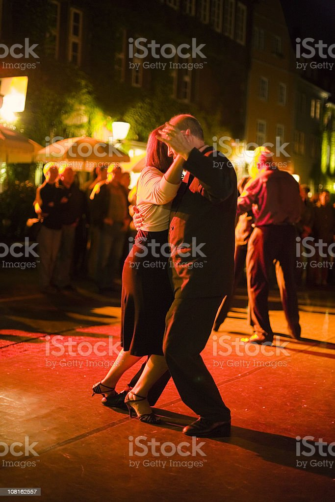 Portrait of Couple Dancing Outdoors at Night royalty-free stock photo