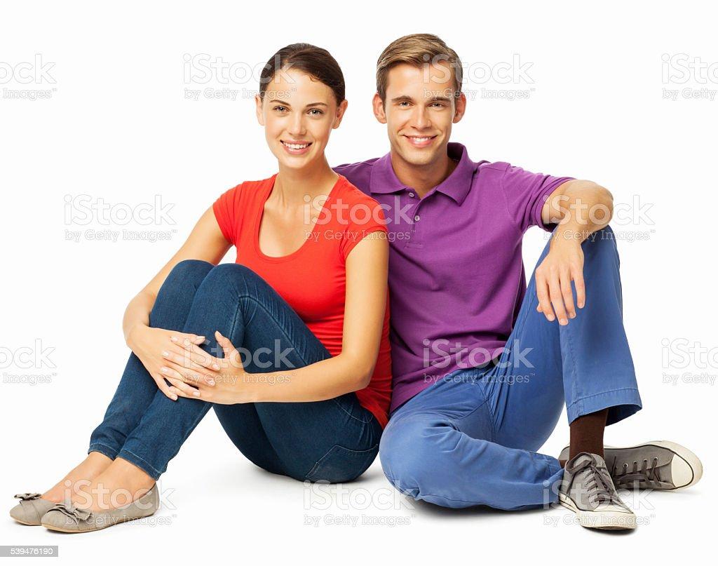 Portrait Of Couple Sitting On Floor stock photo