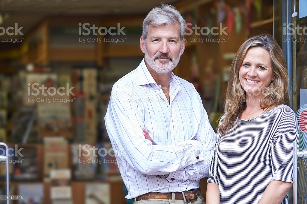 Portrait Of Couple Who Own Bookshop Outside Store stock photo
