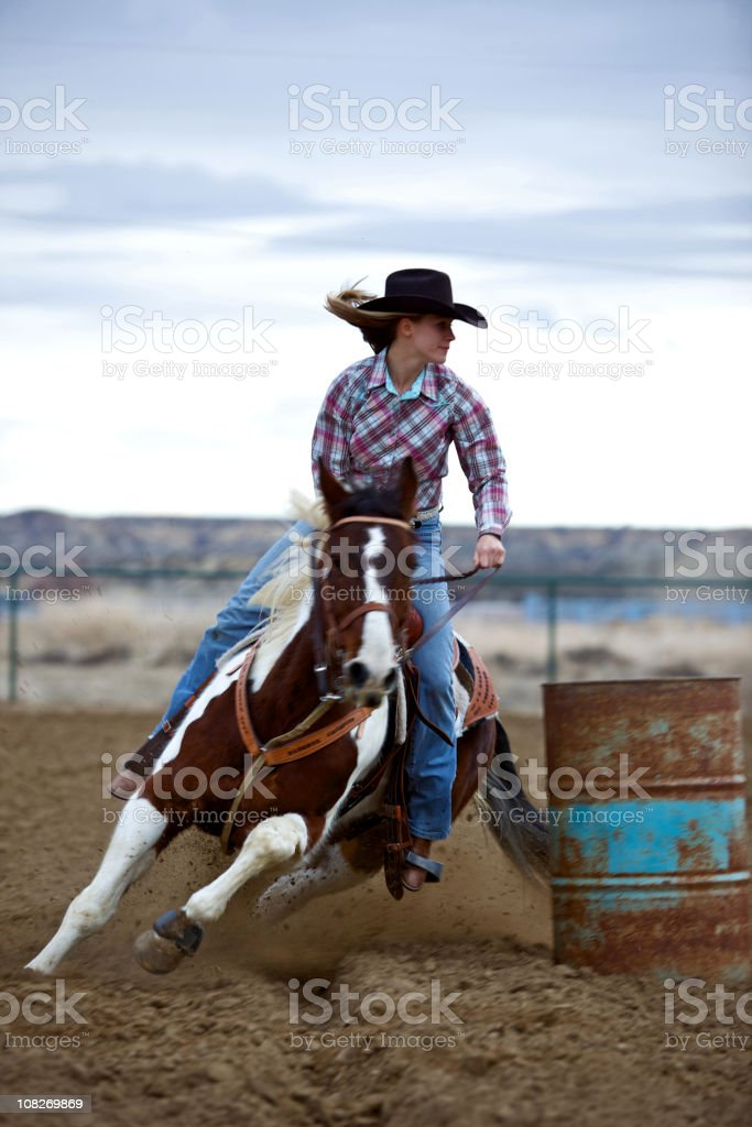 Portrait of Cowgirl Barrel Racing at Sunset stock photo