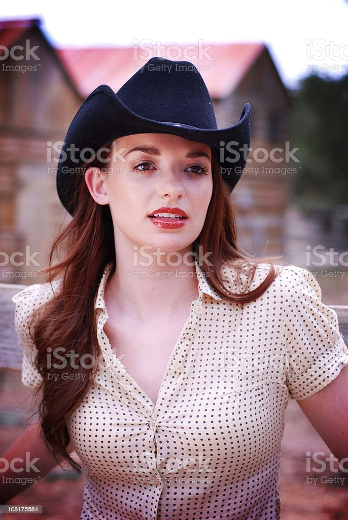 Portrait of Cowgirl Standing at Ranch royalty-free stock photo