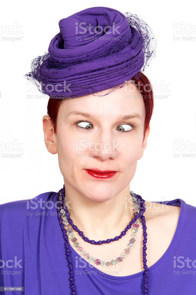 portrait of cross-eyed woman with purple vintage hat stock photo