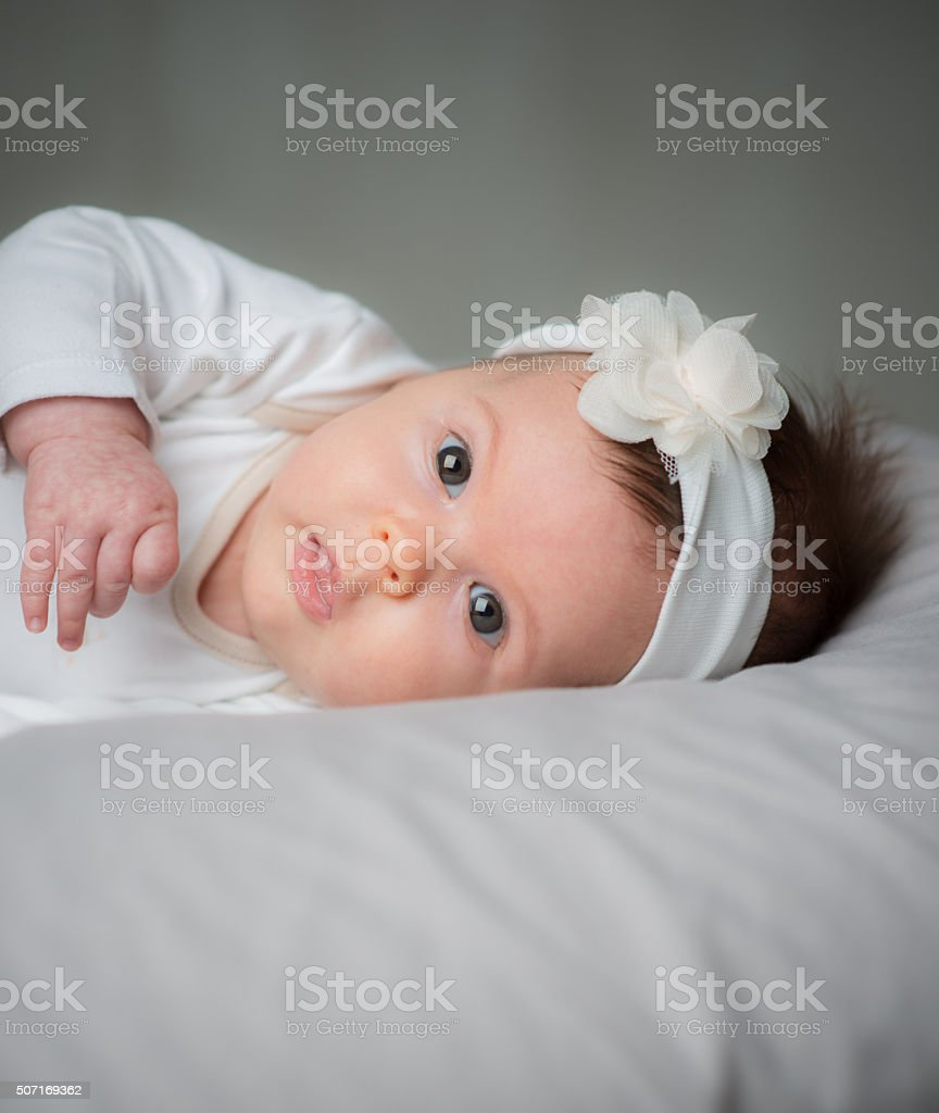 Portrait of cute 6 months baby girl stock photo