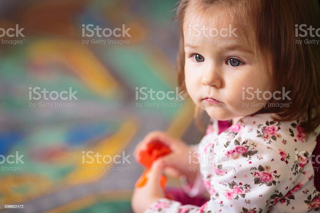 Portrait of cute baby girl playing stock photo