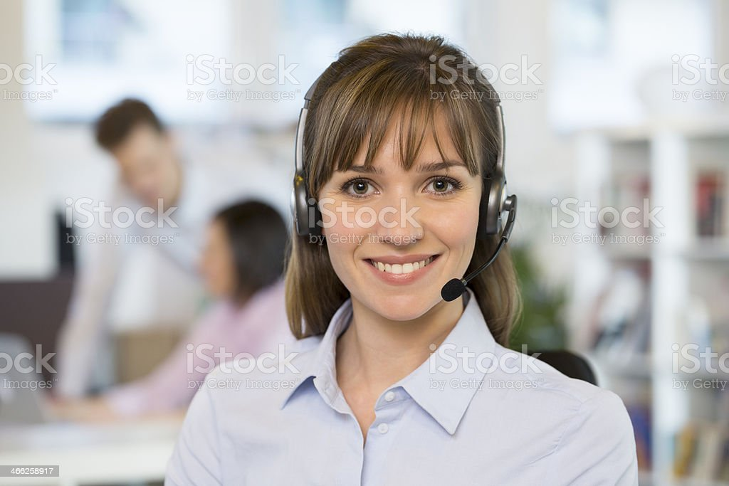 Portrait of cute Businesswoman in office on the phone, headset stock photo