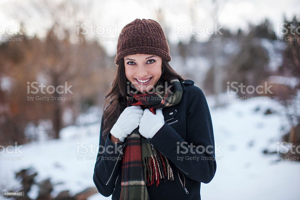 Portrait of Cute Girl Surrounded by Snow stock photo