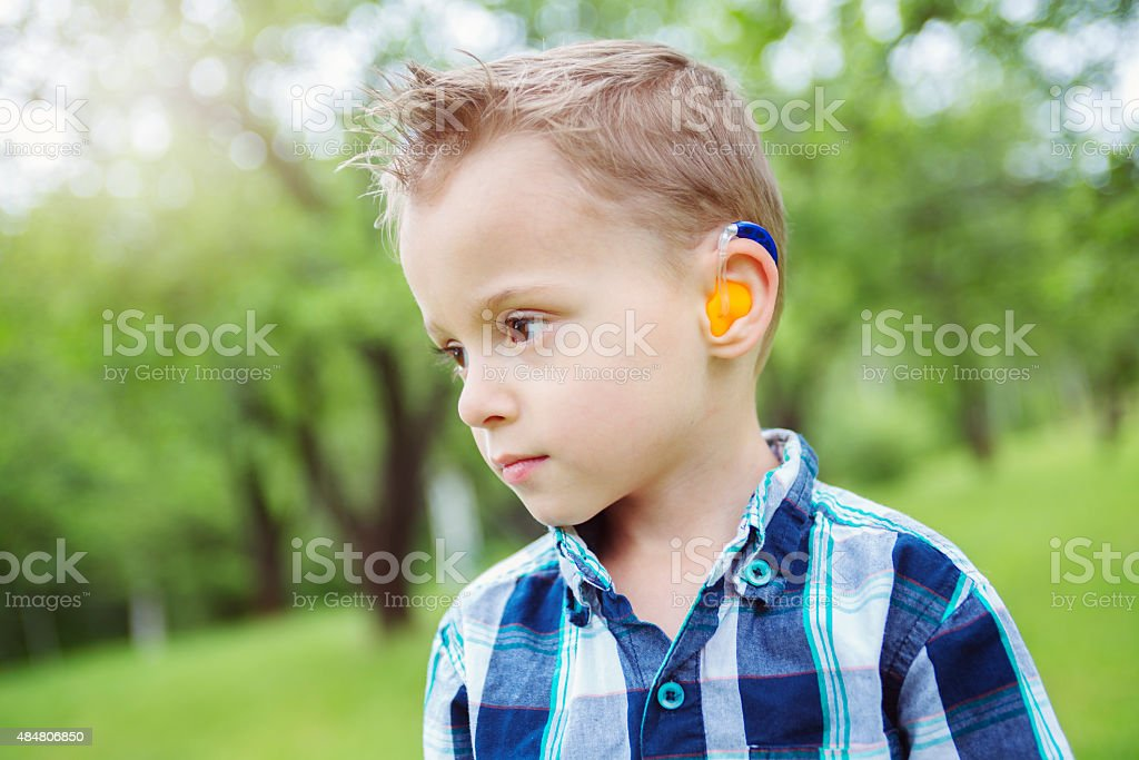 Portrait of cute little boy child outdoors on the nature stock photo