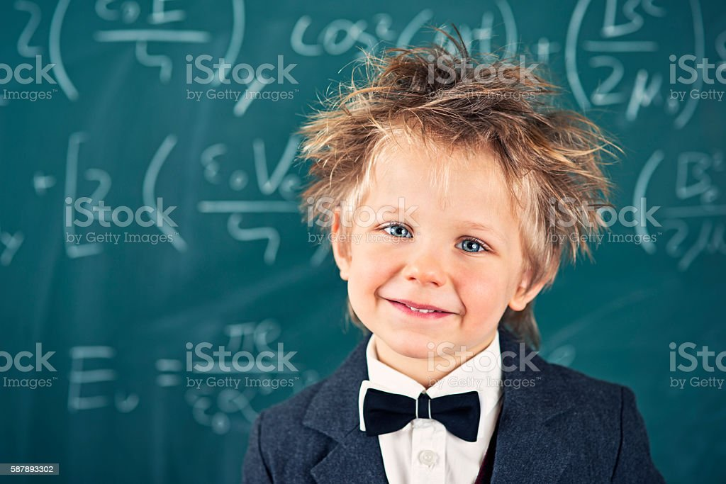 Portrait of cute little genius at school stock photo