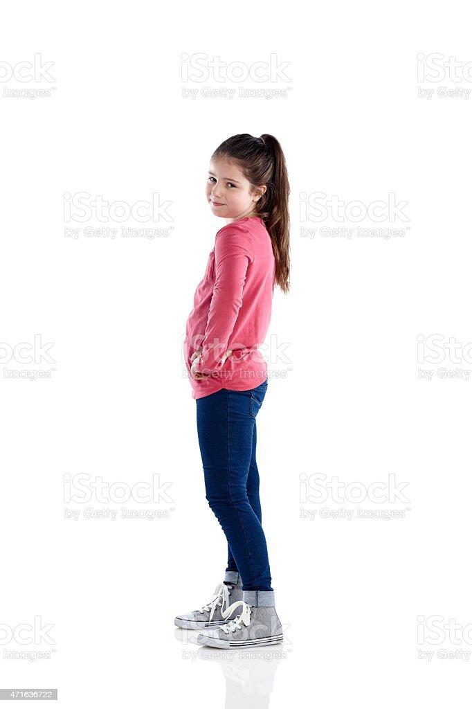 Portrait of cute little girl standing on white stock photo
