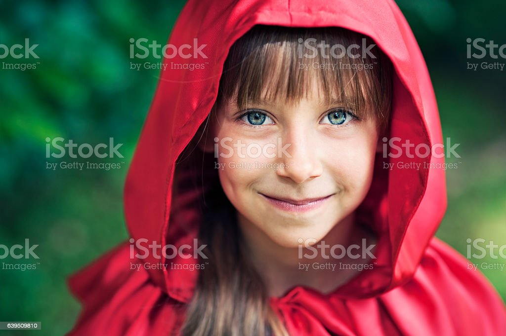 Portrait of cute smiling Little Red Riding Hood stock photo
