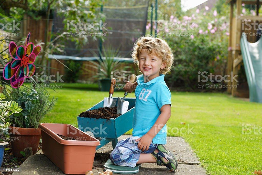 Portrait Of Cute Toddler/ Little Boy Gardening stock photo